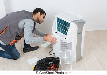 Man working on mobile air conditioning unit