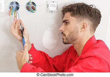 man working on power socket