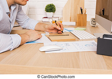 Man working on report side