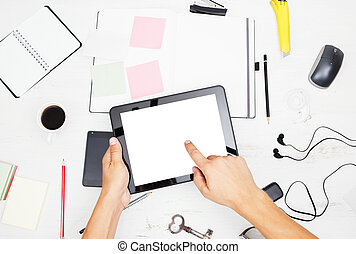 Man working on tablet pc with blank screen, notepad and smart p