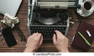 Man working on typewriter - Cropped shot of man typing on...