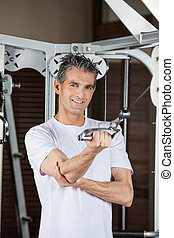 Man Working Out In Fitness Center - Portrait of happy mature...
