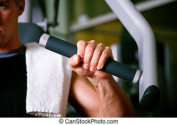 Man working out in gym - Man working out in the Gym on a ...