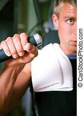 Man working out in gym - Man working out in the Gym on a...
