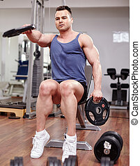Man working with dumbbells