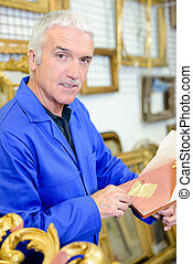 Man working with gold leaf