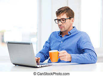man working with laptop at home - technology, business and...