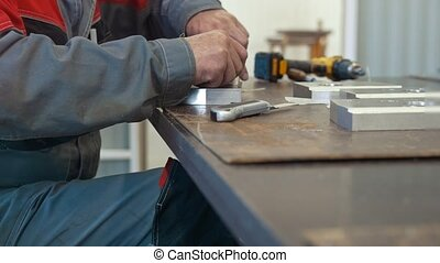 Man working with metal object for manufacturing industrial...