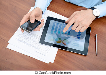 Man working with modern devices - Young businessman working...