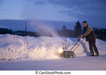Man working with snow plough