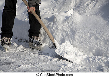 Man working with snow shovel