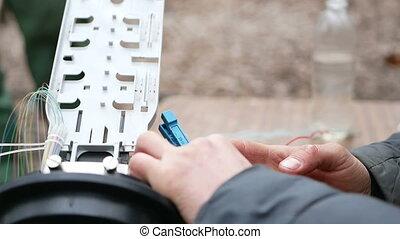 Man works with fiber optic