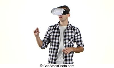 Man works with files in virtual reality glasses. White...