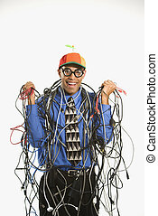 African American businessman wrapped in computer cables wearing nerd hat and glasses.