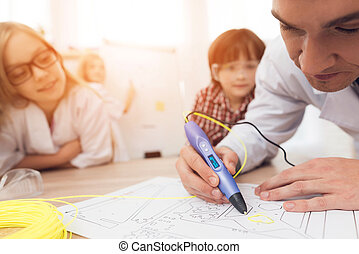 Man writes by 3d pen during a lesson in class.