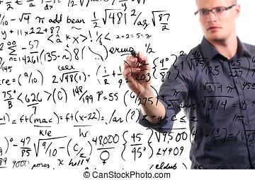 man writes mathematical equations on whiteboard