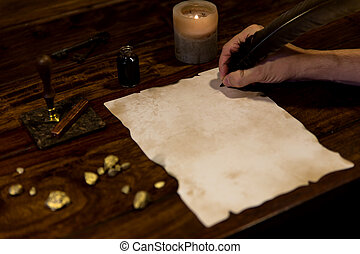 man writes on a old parchment