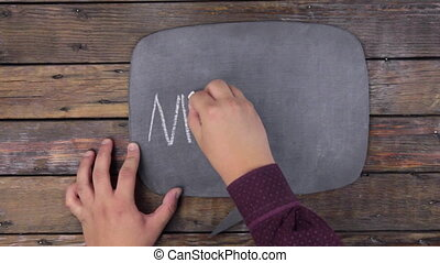 Man writes the word MINTING with chalk on a chalkboard, stylized as a thought.