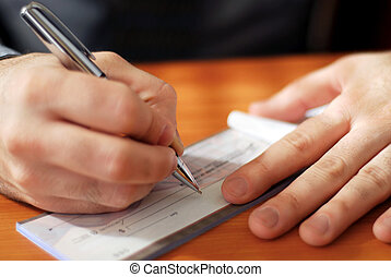 Man writing a check - Closeup on man`s hands writing a check