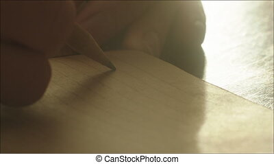 Man Writing a Letter with Lead Pencil