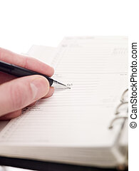 Man writing in an Personal Organizer, short focal lenght