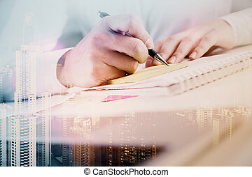 Man writing in notepad multiexposure