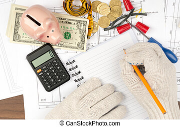 Man writing in pad with piggy bank