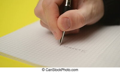 Man writing notes in notebook, close up steady footage with...