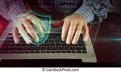 Man writing on laptop keyboard with shield - Man typing on...