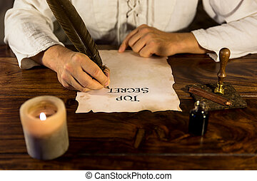 Man writing on parchment Top Secret