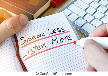 Man writing quote Speak less listen more.
