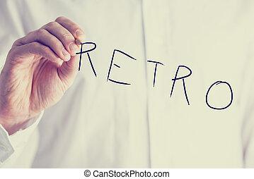 Man writing the word Retro on a virtual screen