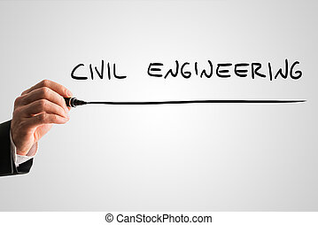 Man writing the words Civil engineering with a black marker...