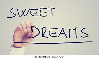 Man writing the words - Sweet Dreams
