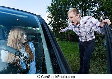 Man yelling at female driver - Young man screaming at a...