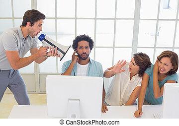 Man yelling through megaphone at business people - Man ...