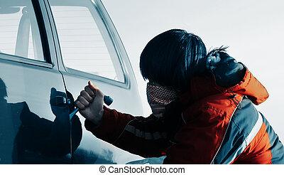 Man - Young man breacking door of a car