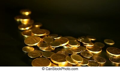 Golden coins on black background. Success of finance...