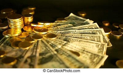 Management efficiency. Stacks of golden coins dollar notes on black background. Success of finance business, investment.