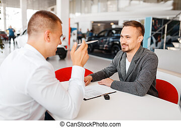 Manager and buyer make out the purchase of new car