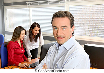 Manager and employees in office