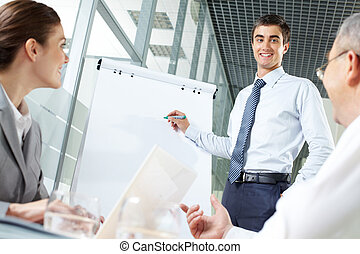 Manager at work - Smiling business man presenting new...