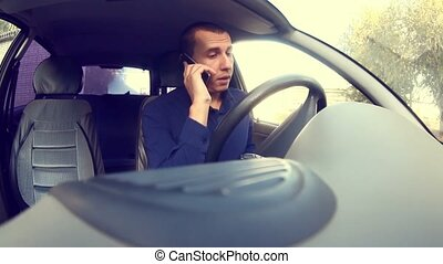 Manager businessman man driving car and talking on a mobile...