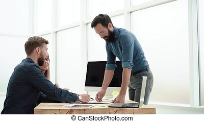 Manager discussing business documents with employees . business concept.