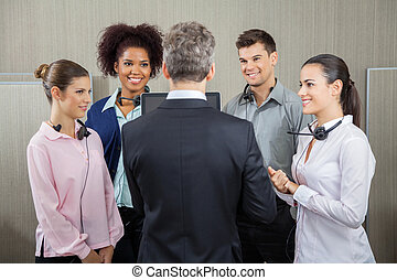 Manager Discussing With Employees - Manager discussing with...