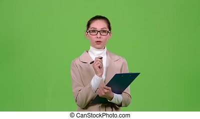 Manager fills the questionnaire with a pen on a paper tablet. Green screen. Slow motion