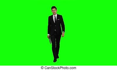 Manager goes to meetings and holds the documentation. Green screen