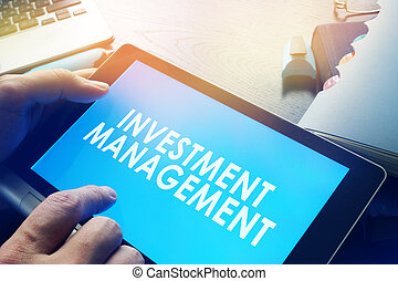 Manager holding investment management report.