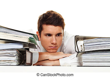Manager in stress with stacks of files - A manager in the...