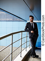 Manager in suit - Serious businessman in suit standing by...